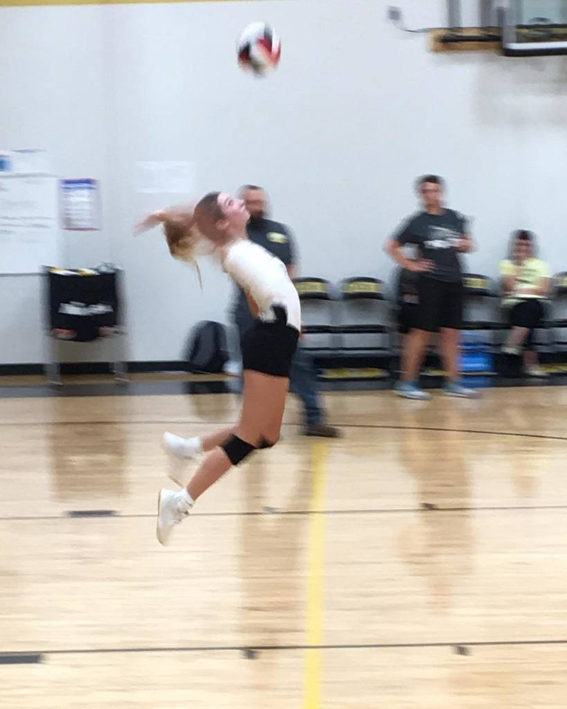Audrey Smith playing on the Lathrop Volleyball Team