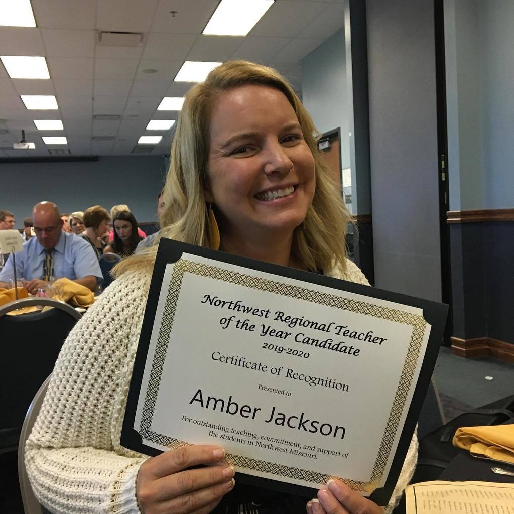 Amber Jackson showing off her teacher of the year award