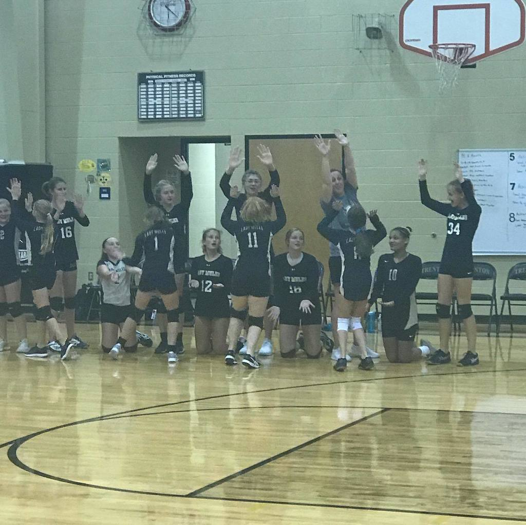 MS Volleyball team cheering each other on during the game