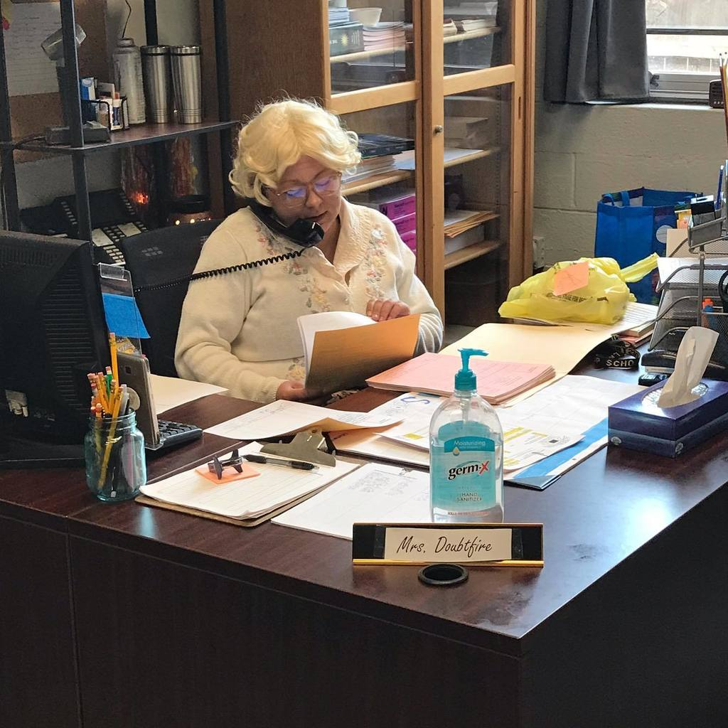 Mrs. Doubtfire taking calls in the LMS main office.